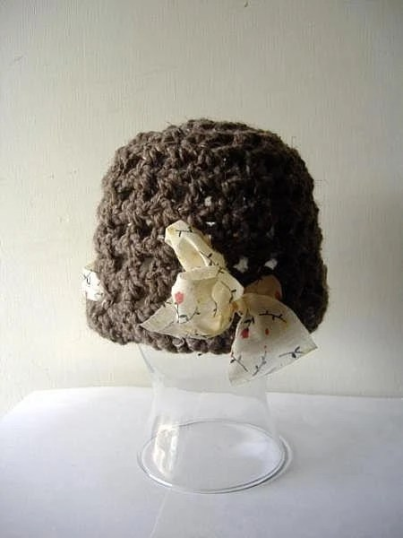 the miss peabody hat in brown.