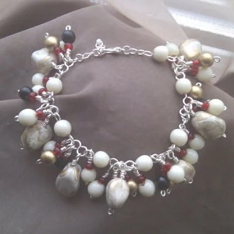 Black, Cream, Gold Red coloured  Gypsy Tumble Charm Bracelet
