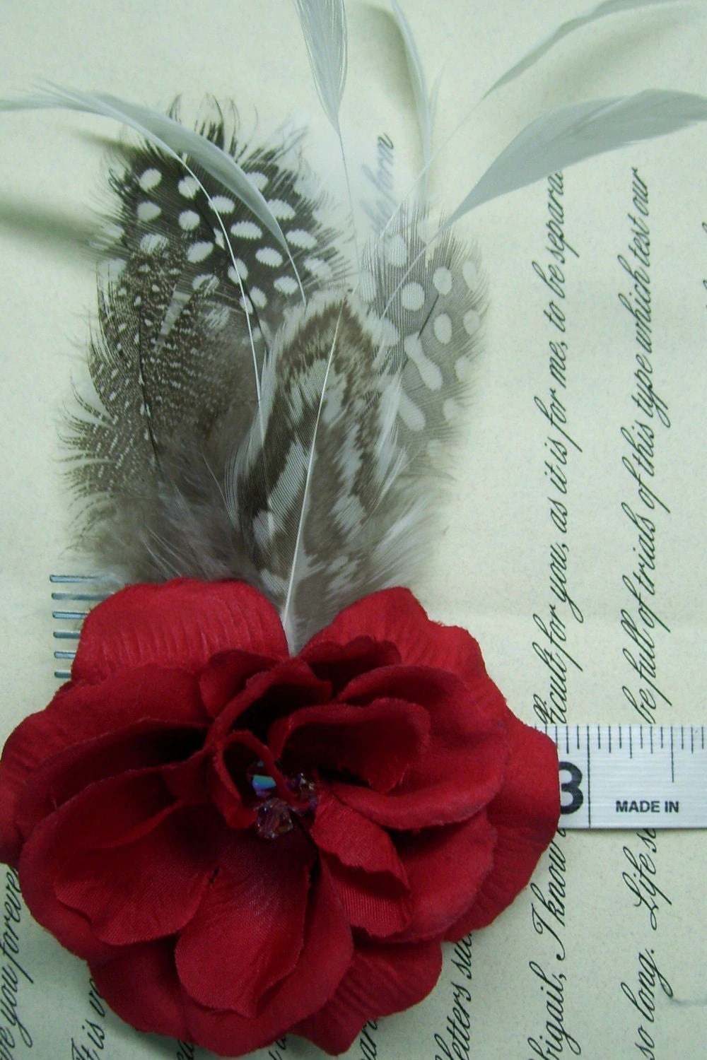 red flower and guinea feather hair clip