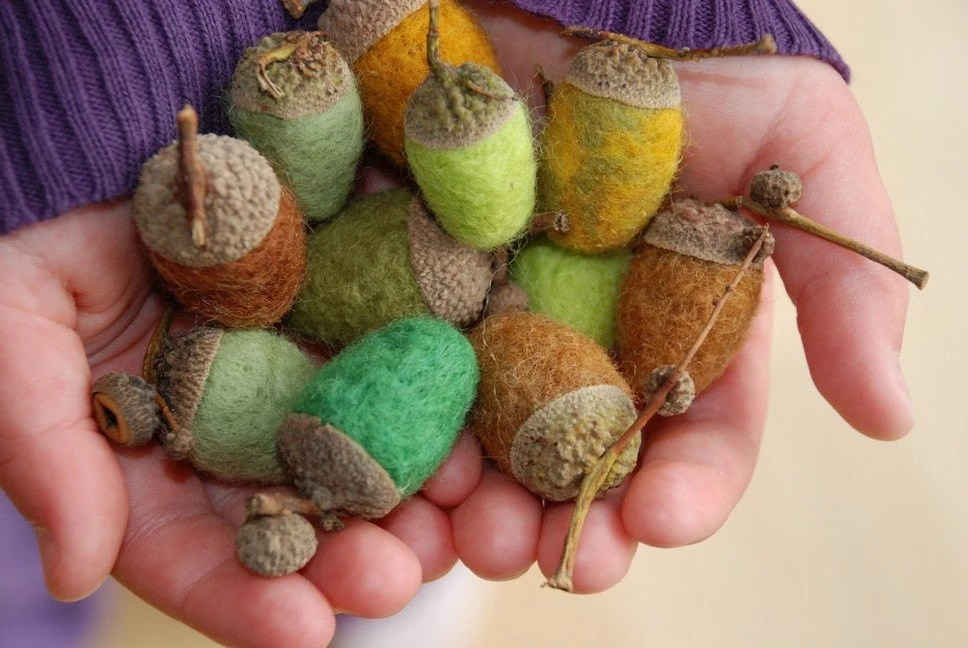 a handful of Felted Acorns