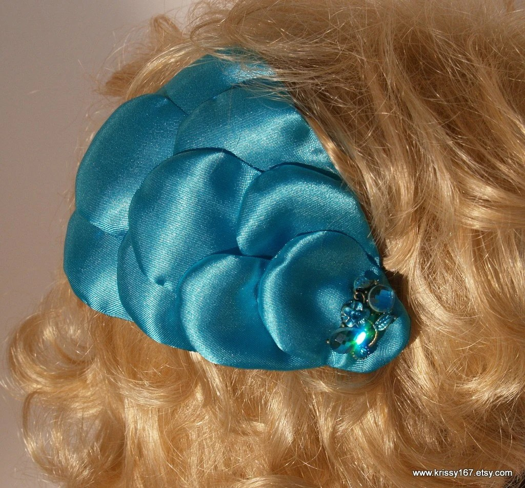 Multi use fashion accessory.  Teal hair fascinator or lapel clip or brooch.  Marge.