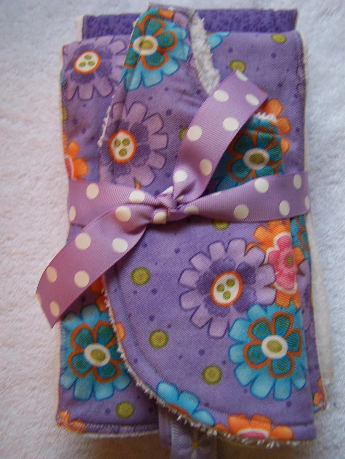 Baby burp cloth and bib set. purple, pink, turquiose flowers. 3 piece Boutique style baby shower gift.