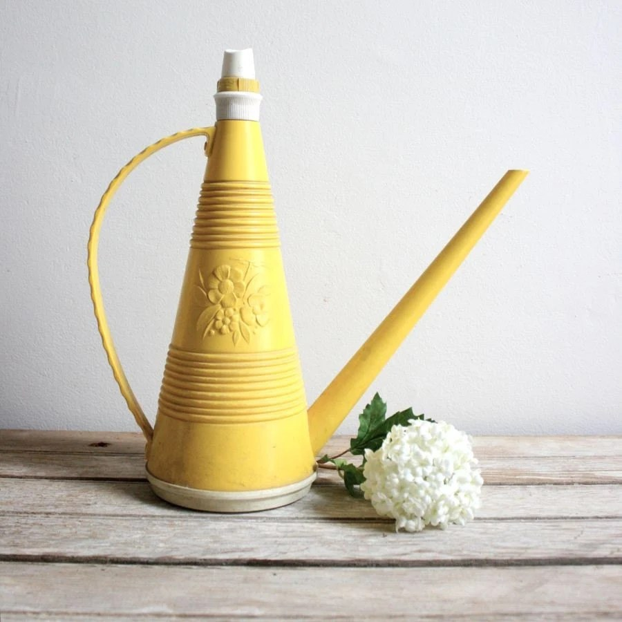 vintage yellow floral watering can
