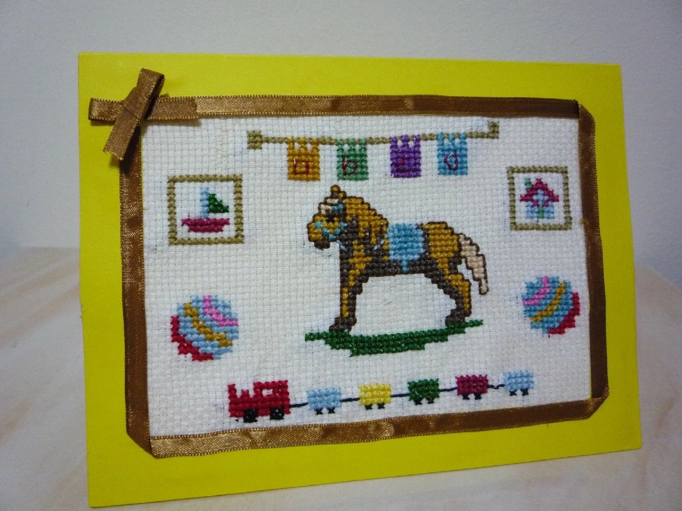 Crafttreasures cross-stitch design will bring any child into their own imaginary American Wild West.  With a rocking horse and train, all your little cowboy needs is a 10-gallon hat!  See more at http://www.etsy.com/shop.php?user_id=6979186