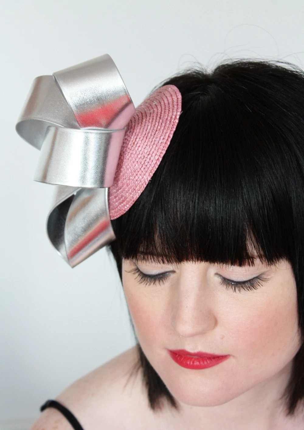 Silver leatherette loops fascinator on pink straw