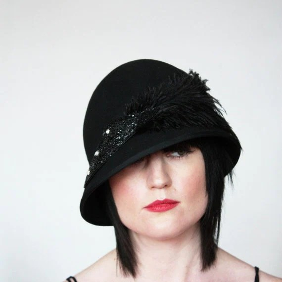 Reserved for Claire - Asymmetric brimmed cloche with bugle bead embellishment and feather
