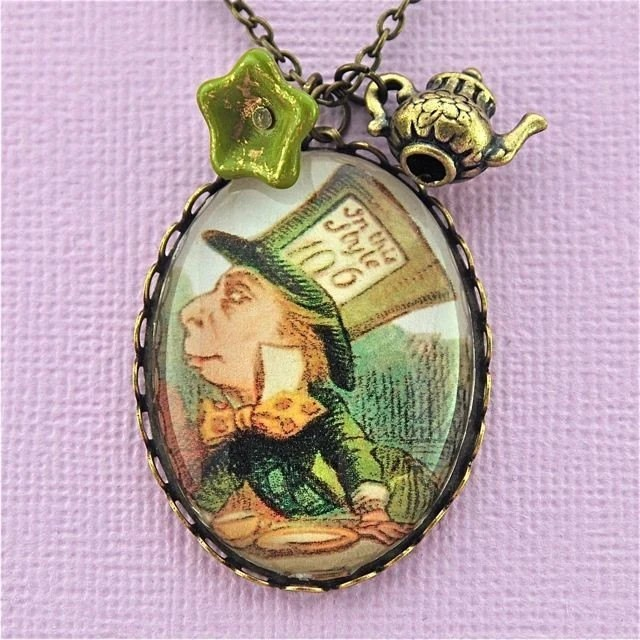 Alice in wonderland inspired jewellery, mad hatter locket necklace pendant