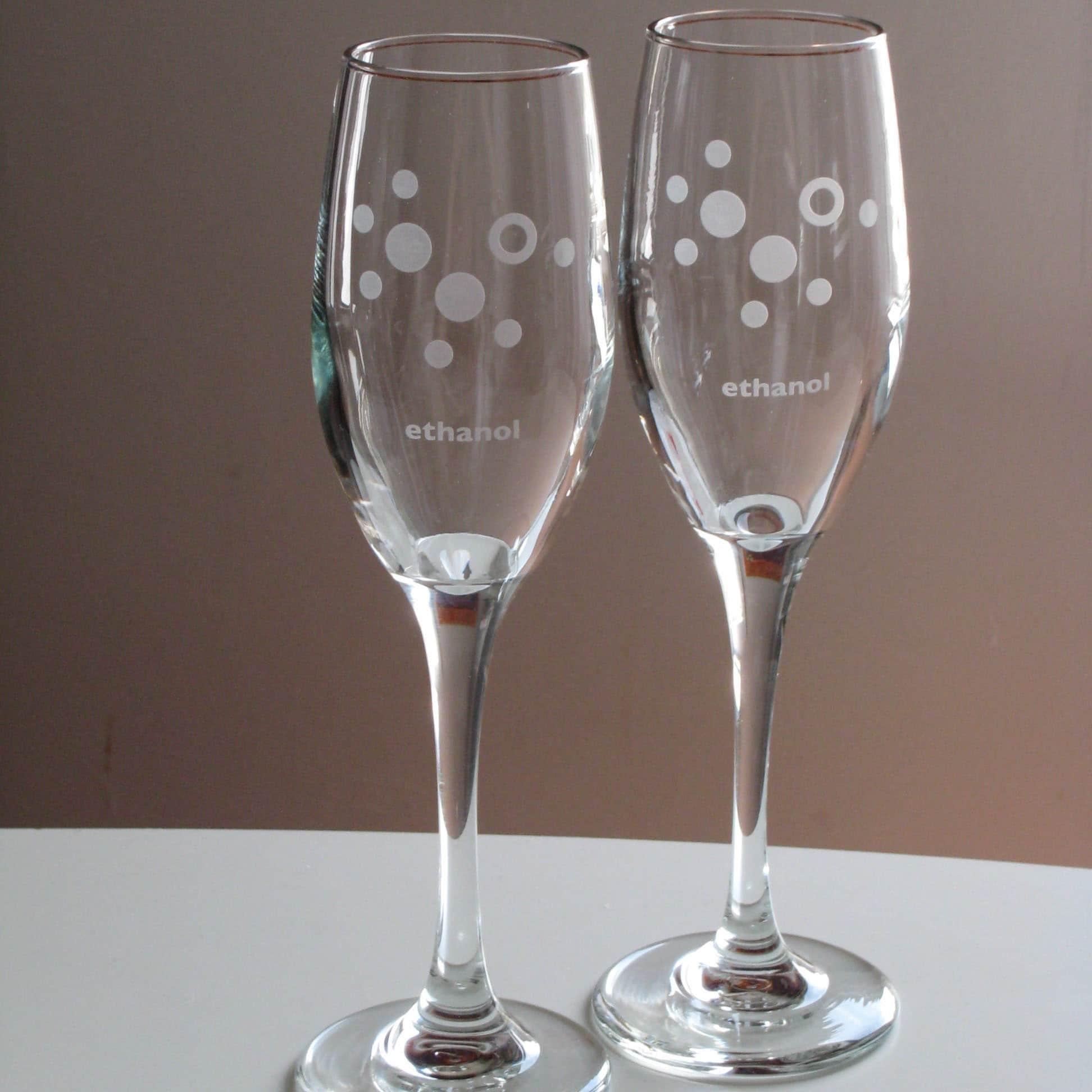 etched ethanol molecule champagne glasses