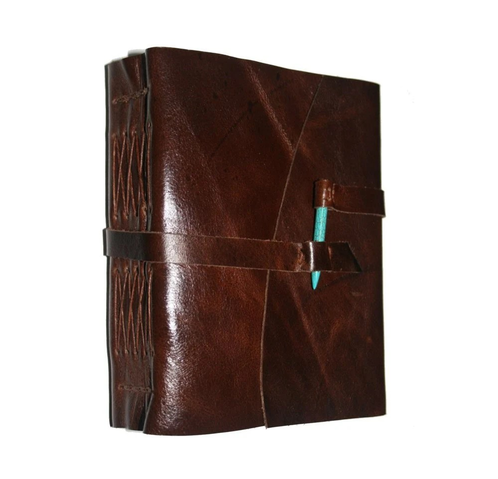 Distressed brown handbound leather journal with Turquoise spike closure