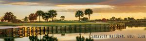 Golf greens with water at sunset