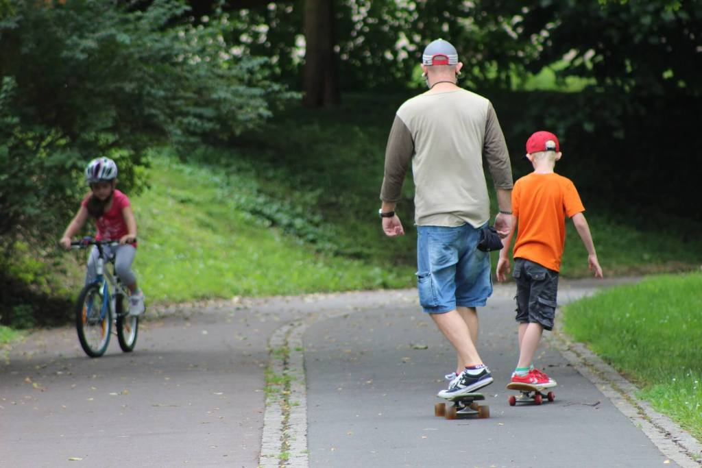 father and son skateboarding together
