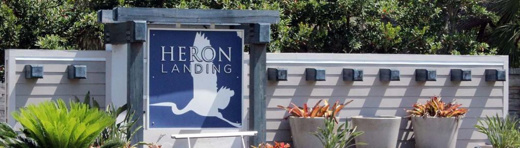 heron landing sign