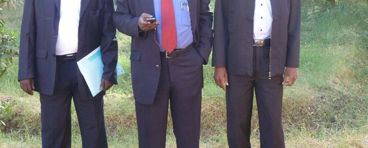 South Sudan's former Deputy Foreign Minister Elias Nyamlell Wakoson (M) posting for a picture with comrades(Photo: file)