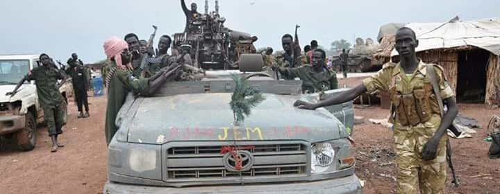 SPLA-IO rebel forces pose with vehicles and equipments captured from Darfur rebels fighting along side forces loyal to President Salva Kiir in Western Bahr El Ghazal.