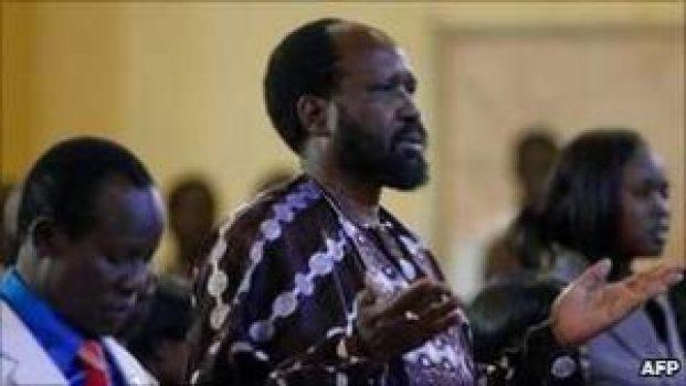 President Salva Kiir prays on Sunday at a church in the South Sudan Capital.