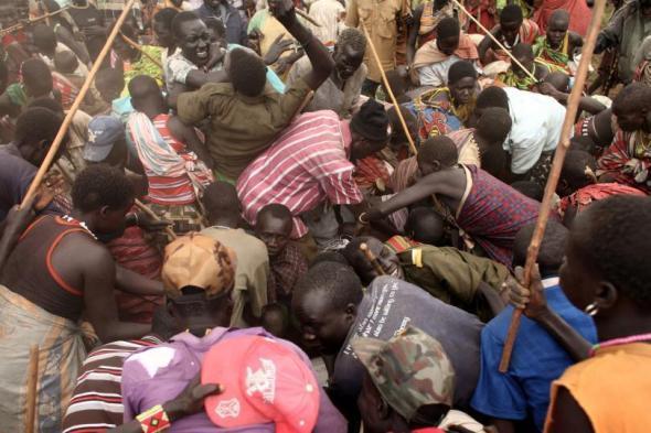 civilians scramble for humanitarian aid in famine hit Jonglei, South Sudan.