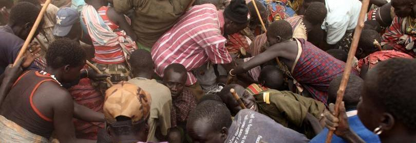 civilians scramble for humanitarian aid in famine hit South Sudan.