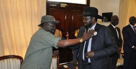 Former army chief Gen. Paul Malong Awan Greeting President Salva Kiir