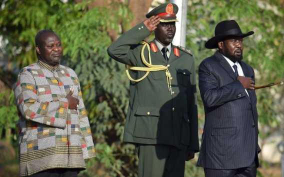 President Salva Kiir of South Sudan, right, with the opposition leader, Riek Machar, left, as Mr. Machar was sworn in as vice president on Tuesday. April 2016, in Juba, South Sudan(Photo: file)
