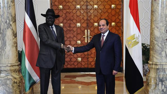 A handout picture released by the Egyptian Presidency shows Egyptian President Abdel Fattah el-Sisi (R) shaking hands with South Sudan's President Salva Kiir at the presidential palace in the Egyptian capital, Cairo, January 10, 2017. (Photo by AFP)