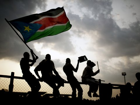 Southern Sudanese wave flags and cheer at the Republic of South Sudan's first national soccer match in the capital of Juba on Sunday, July 10, 2011. The game, played against Kenya, comes just one day after South Sudan declared its independence from the north following decades of costly civil war. Today, South Sudan cannot even afford to send its soccer team to attend regional games in neighboring countries as effects of war take over(AP Photo/Pete Muller)