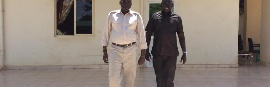 Late Bol Deng Miyen walking side by side with his hero, Gen. Paul Malong Awan, who was under house arrest in the capital, Juba(Photo: profile)