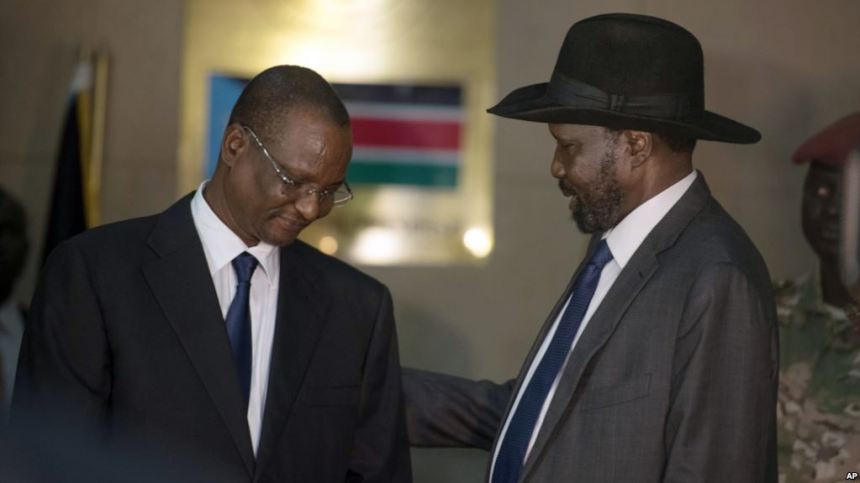 South Sudan First Vice President Taban Deng Gai , left, speaks with President Salva Kiir , right, Tuesday, July 26, 2016, after Taban was sworn in at the presidential palace in Juba, South Sudan, replacing opposition leader Riek Machar. South Sudan's president on Tuesday replaced his deputy and opposition leader Riek Machar, who fled into hiding this month amid renewed clashes with government forces. The move threatens an already fragile peace deal in a country ravaged by civil war. (AP Photo/Jason Patinkin)