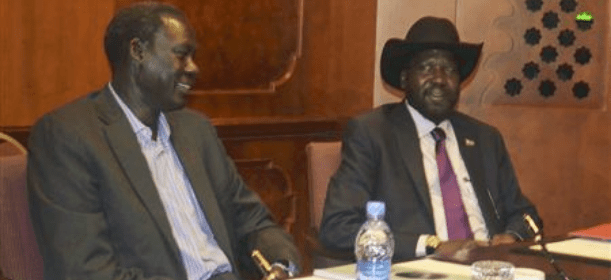 South Sudan's President Salva Kiir (R) sits with South Sudan's Foreign Affairs Minister Deng Alor, also a member of the Dinka ethnic group, at the meeting table at the Sheraton hotel in Ethiopia's capital Addis Ababa(Photo: REUTERS/Tiksa Negeri)