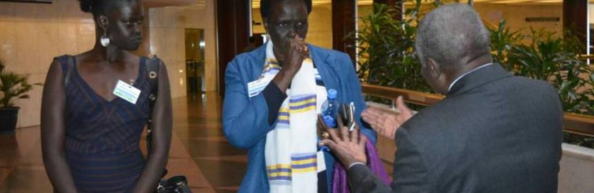 Nhial Deng Nhial, a leading member of government delegation pleads to Dr. John Garang's widow, Mama Rebecca Nyandeng, a leading members of former detainees(photo: file)