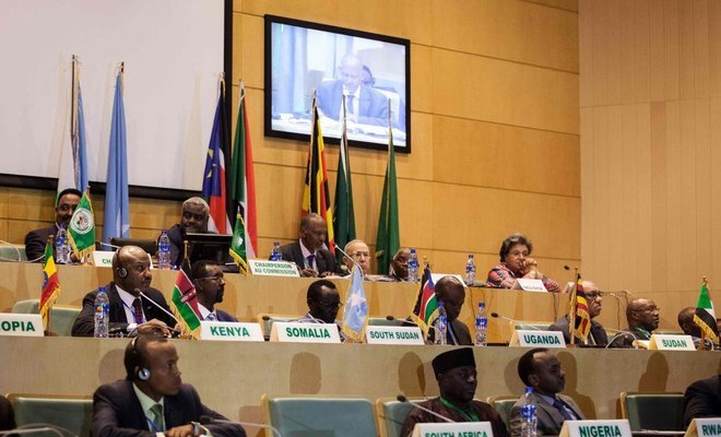 African Union Chairman Musa Faki appear (c) from the back December 21 2018 in Addis Ababa as warring parties signs Cessation of Hostilities Agreement (CoH): File  photos
