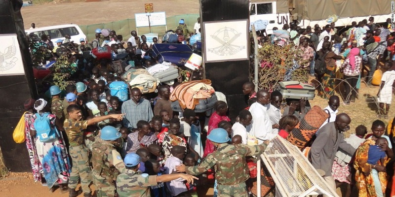 A handout photo released by UNMISS on December 20, 2013 shows civilians gathering outside the UNMISS compound in Juba, on December 16, 2013. (Source CNN)