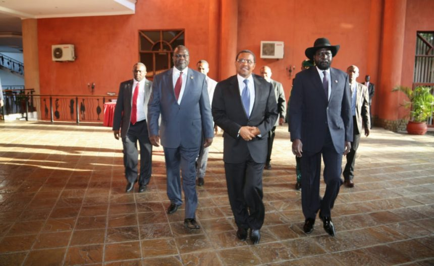 CCM Chairman President Jakaya Mrisho Kikwete walks to the conference hall with the two principal rival leaders - President Salva Kiir Mayardiit, Chairman of SPLM in government and Mr. Riek Machar Teny, former vice president and leader of the SPLM-in-Opposition(Photo credit: Roberto Kanda/Nyamilepedia)