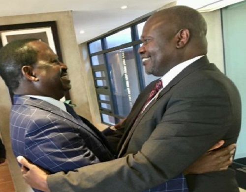 Former Kenyan Prime Minister, Raila Odinga (L) SPLM-IO leader Riek Machar hugs each other as they meet in Pretoria on Friday (File photo)
