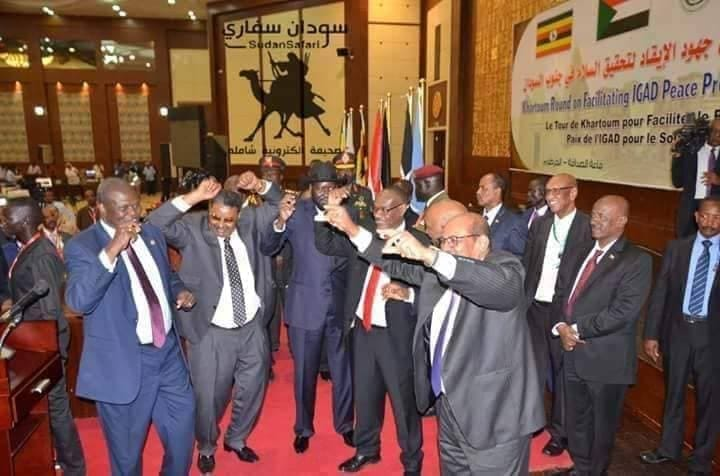 Sudanese President, Omar Hassan el Bashir dances with the South Sudanese leaders in his capital after signing the security arrangement and governance dossiers, August 2018(Photo: supplied/file/Nyamilepedia)