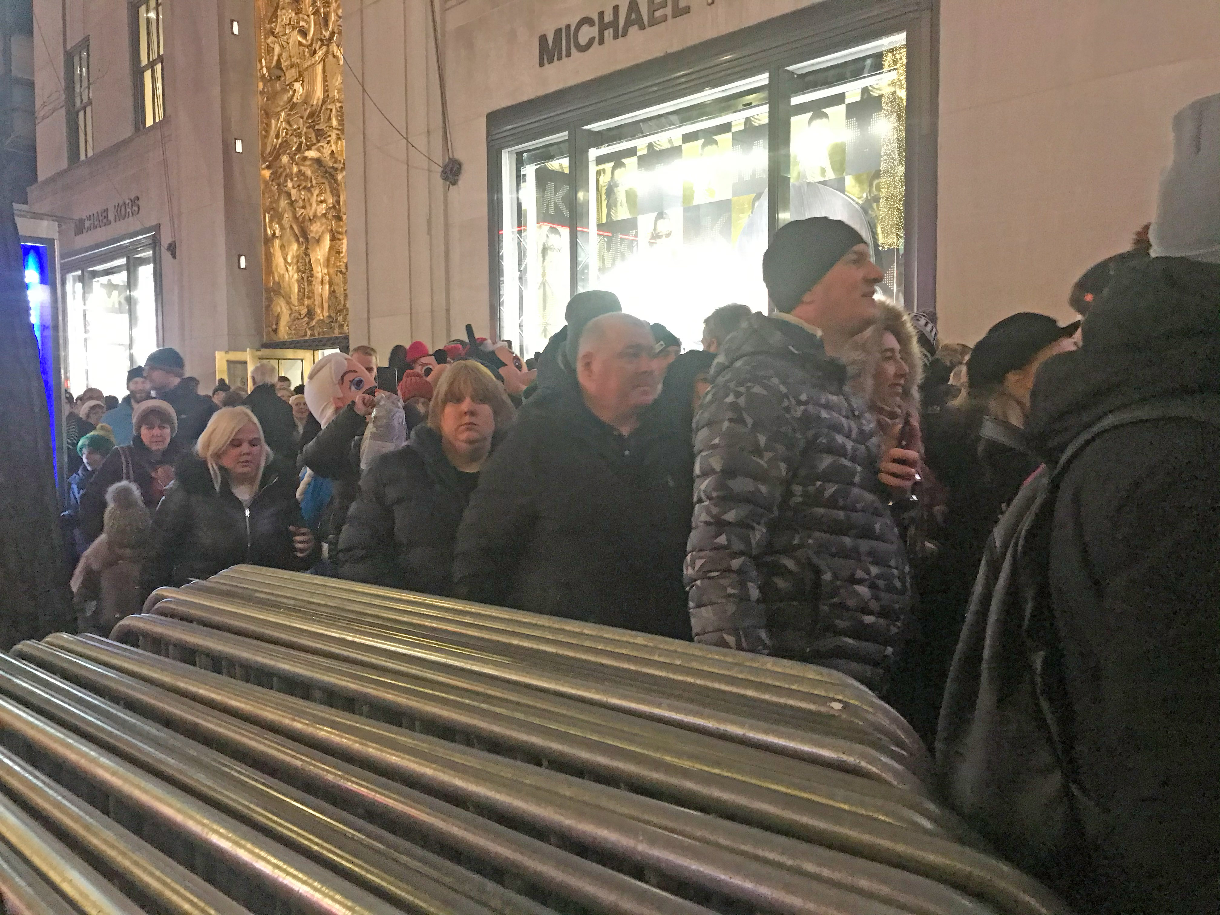 Barriers block people into Fifth Avenue, instead of letting them walk freely between the sidewalk and temporary sidewalk. Photo: Julianne Cuba
