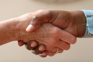 A firm handshake between two people.