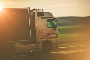 a moving truck on the road -hire movers for a problem-free relocation