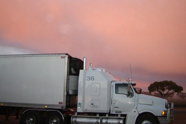 A white truck, pink sky in the background