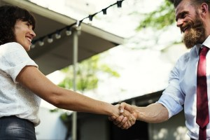 A handshake of a man and a woman.