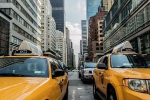 Yellow cabs on the streets of NYC to illustrate leaving Las Vegas for NYC