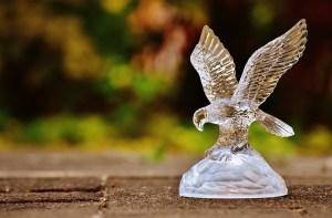 A glass figurine of an eagle.