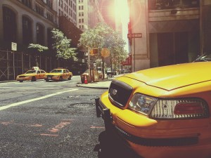 Yellow cabs in a street in New York.