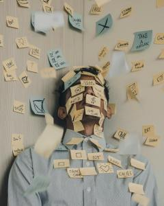A man covered in post-its that have positive messages written on them to help him get rid of stress of moving to NYC from Kentucky.