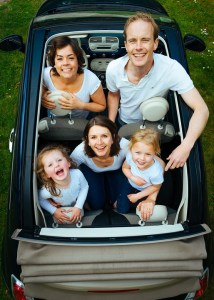 A family in a car during their relocation.