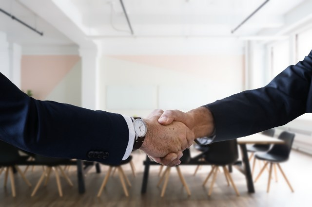 A handshake. One of the reasons to move to Maryland is that you will find good job options.