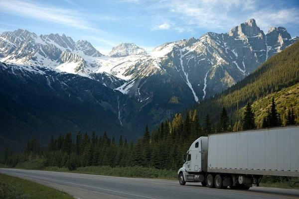 Moving truck with mountains as a background.