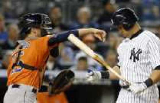 New York Yankees Carlos Beltran holds his bat as Houston Astros catcher Jason Castro (15) returns a ball to the pitcher after Beltran struck out in the fourth inning of the American League wild card baseball game at Yankee Stadium in New York, Tuesday, Oct. 6, 2015. (AP Photo/Kathy Willens)