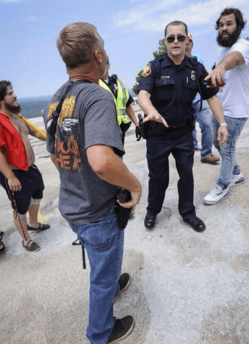 white man gun officer