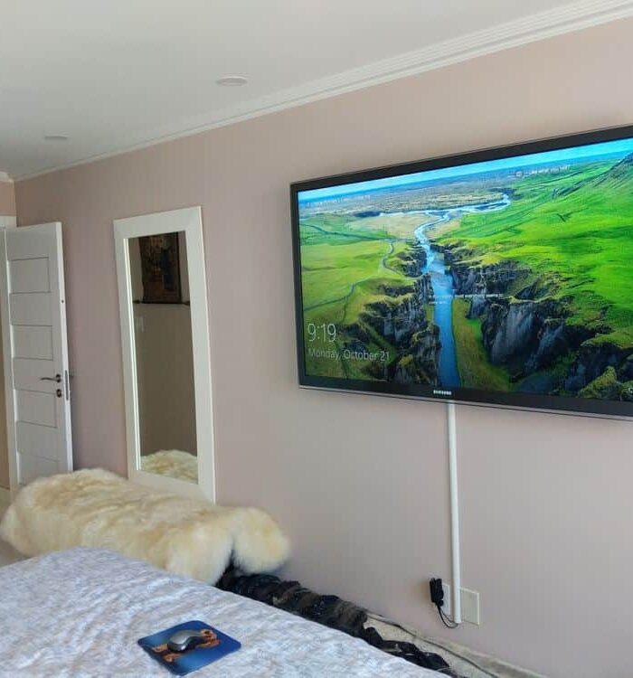 Huge TV on bedroom wall