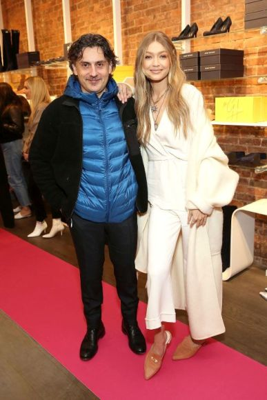 NEW YORK, NY - NOVEMBER 15:  Creative Director at Stuart Weitzman Giovanni Morelli (L) and model Gigi Hadid attend the Stuart Weitzman Pop-Up Event on November 15, 2017 in New York City.  (Photo by Monica Schipper/Getty Images for Stuart Weitzman)